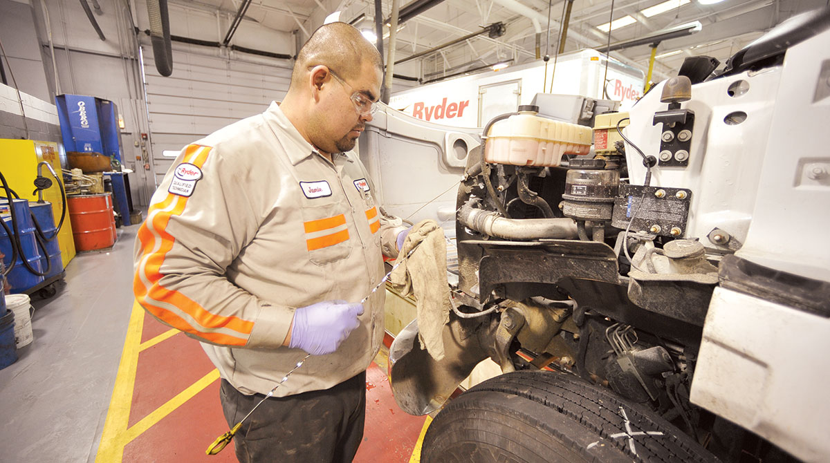 Ryder technician works on truck