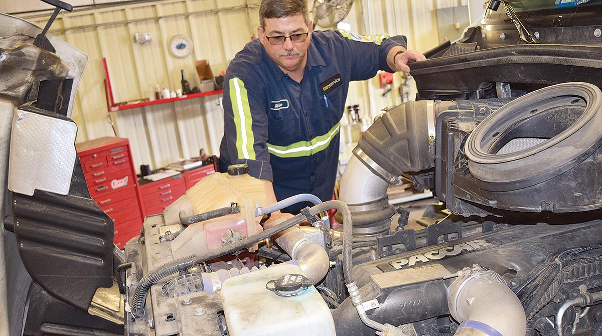 Technician works on an engine