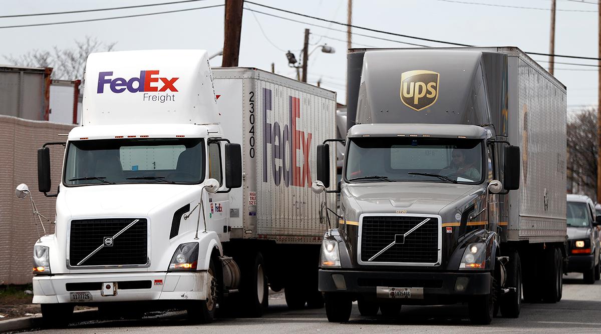FedEx truck and UPS truck