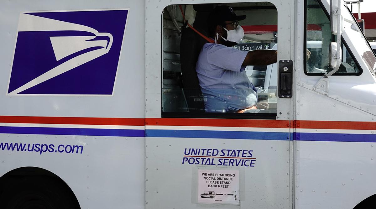 A USPS mail truck (Bing Guan/Bloomberg News)