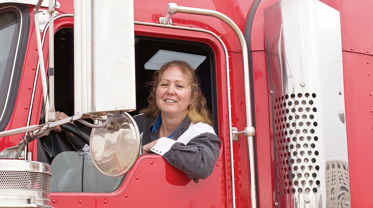 Woman behind the wheel of truck cab