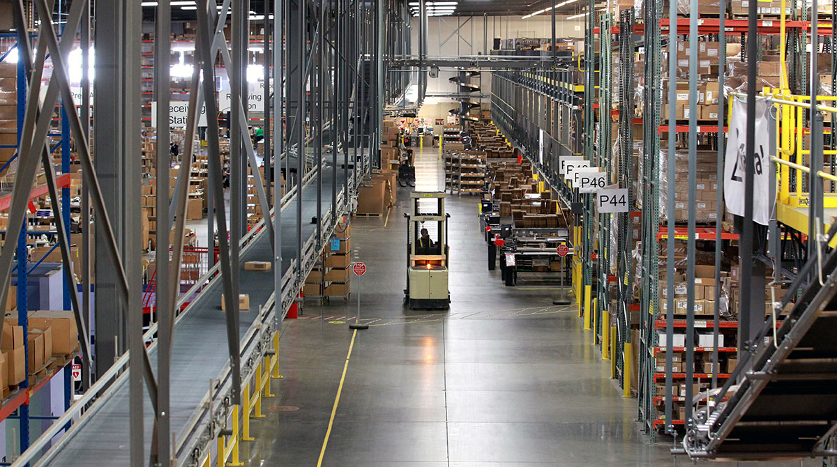 A forklift cruises for loads in a fulfillment center