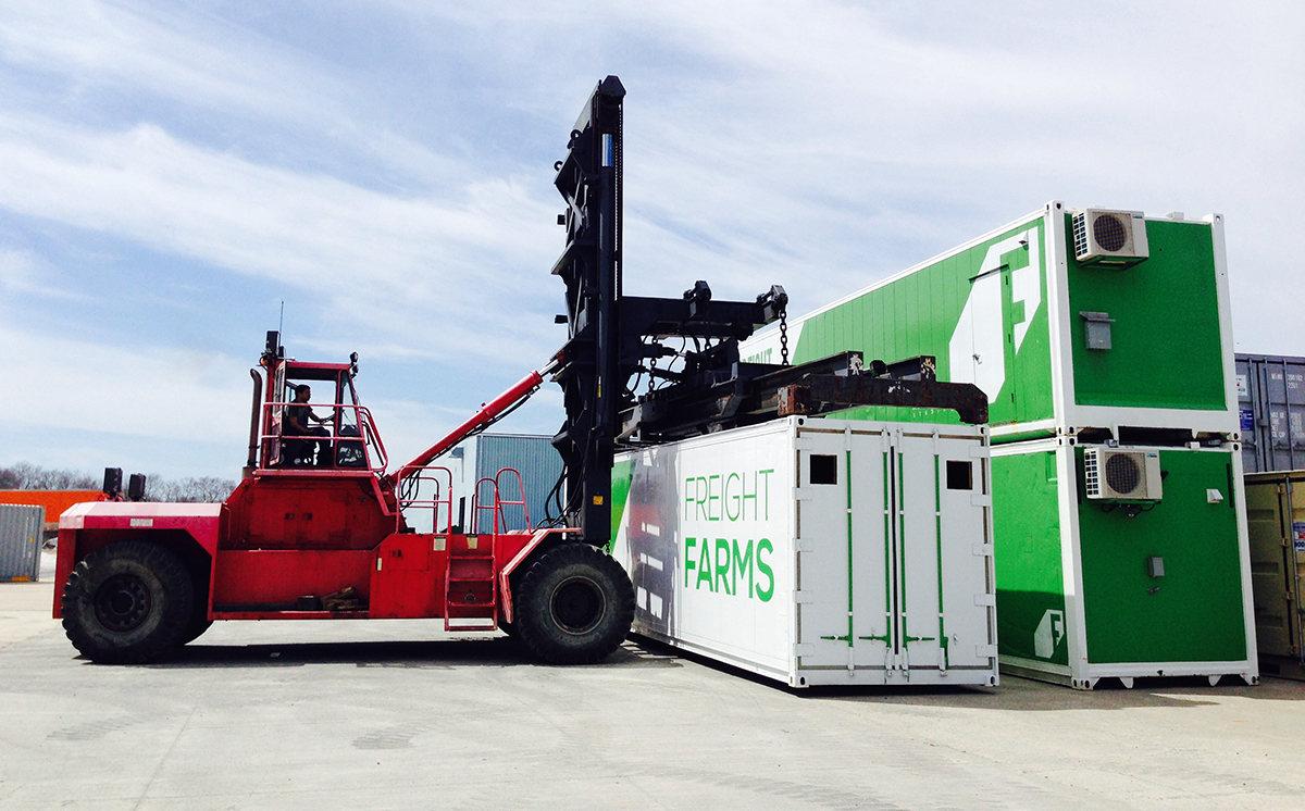 Forklift picks up container at Freight Farms production facility