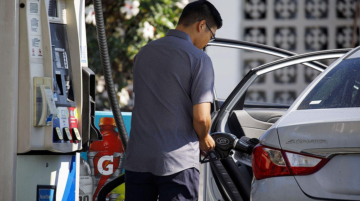 Man refueling car