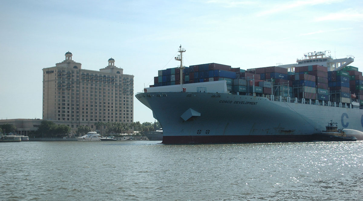 A containership operated by Cosco moves toward the Port of Savannah's Garden City Terminal in May 2017.