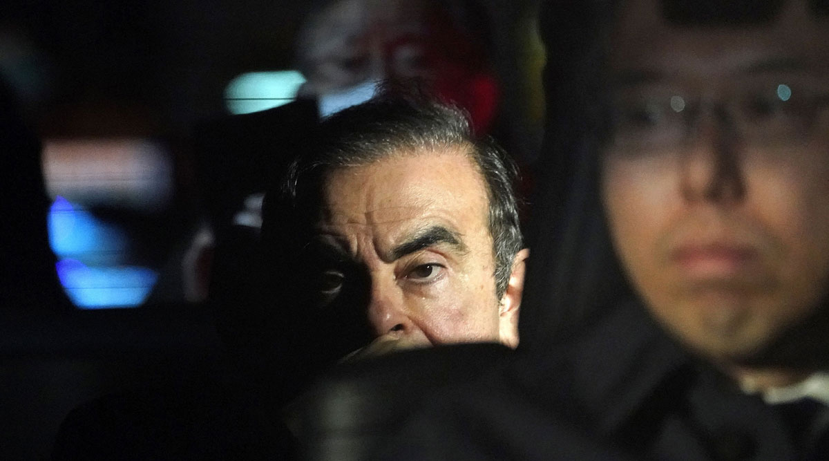 Charles Ghosn sits in a vehicle as he leaves his lawyer's office in Tokyo, Japan, in March 2019.