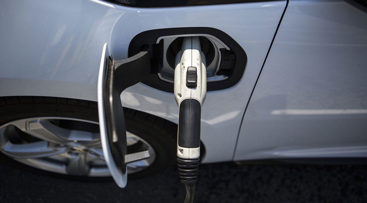 A charging plug is connected to a GM Chevrolet Volt electric vehicle.