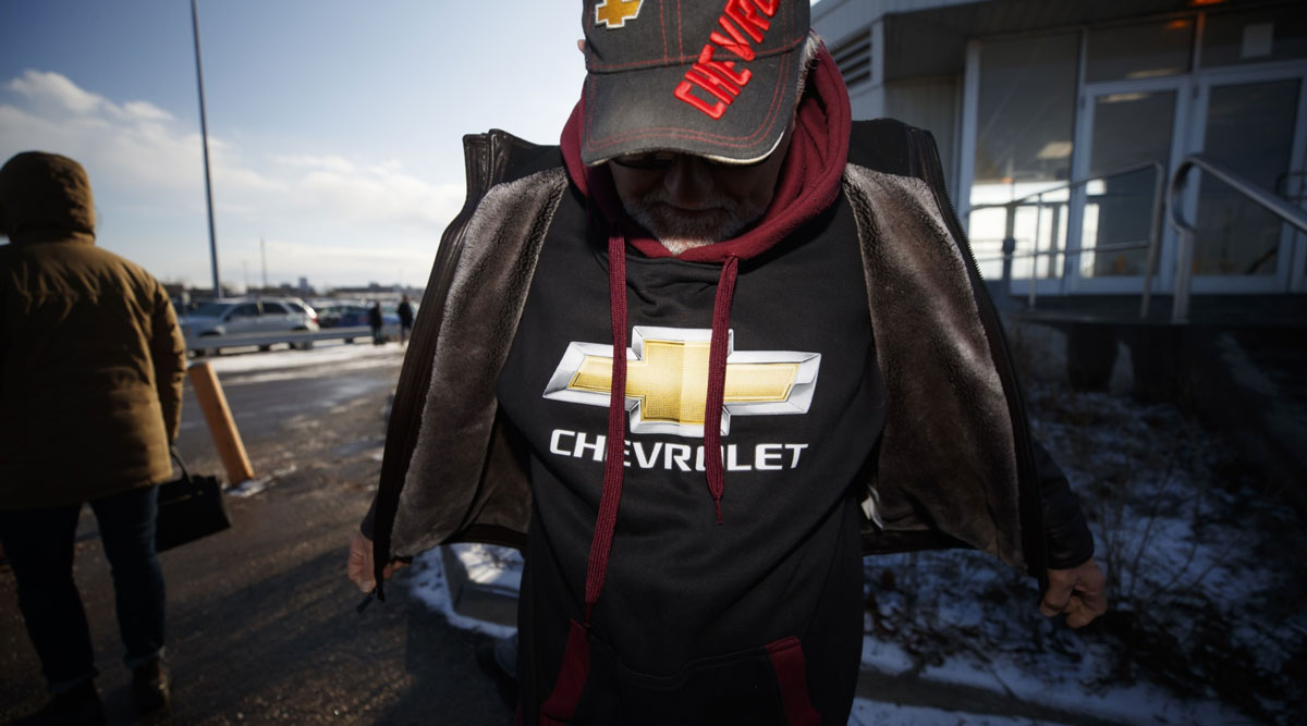 A retired workers wears a Chevrolet sweatshirt outside the GM Oshawa assembly plant in December 2019.