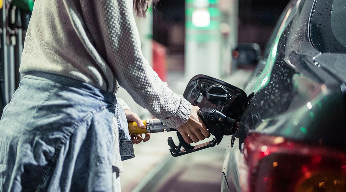Woman pumping gasoline