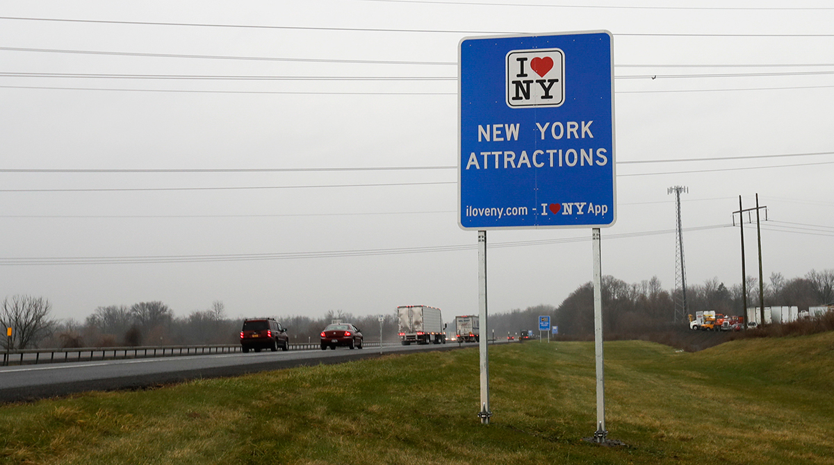 """An """"I Love NY"""" sign on the New York State Thruway"""