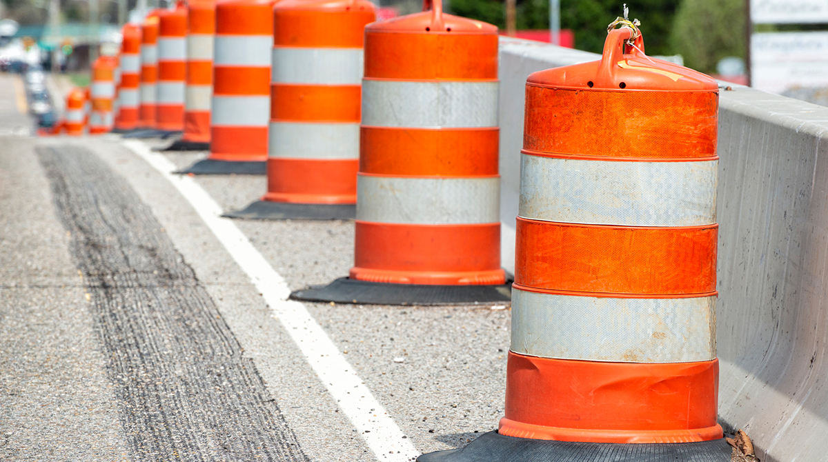 Orange construction barrels