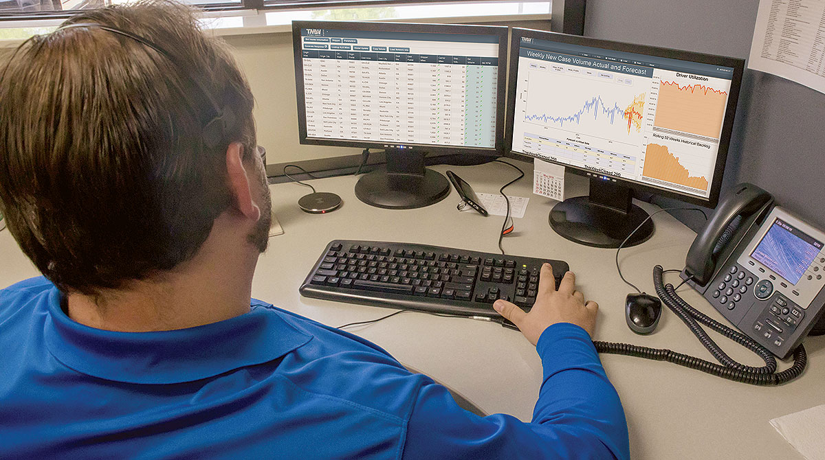 Man tracking fleets on two monitors