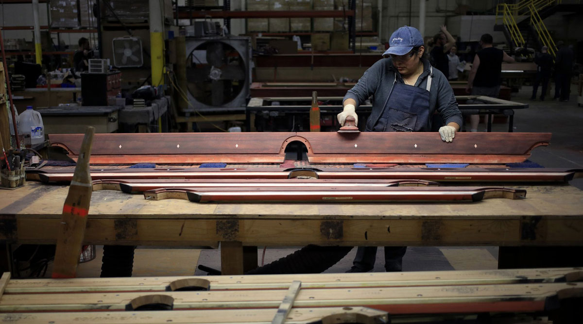 A worker sands wood components for billiard tables at a factory in Indiana. (Luke Sharrett/Bloomberg News)