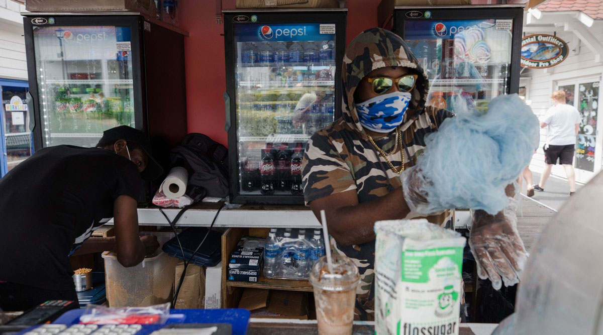 A vendor prepares cotton candy at a food stand in Myrtle Beach, S.C. (Micah Green/Bloomberg News)