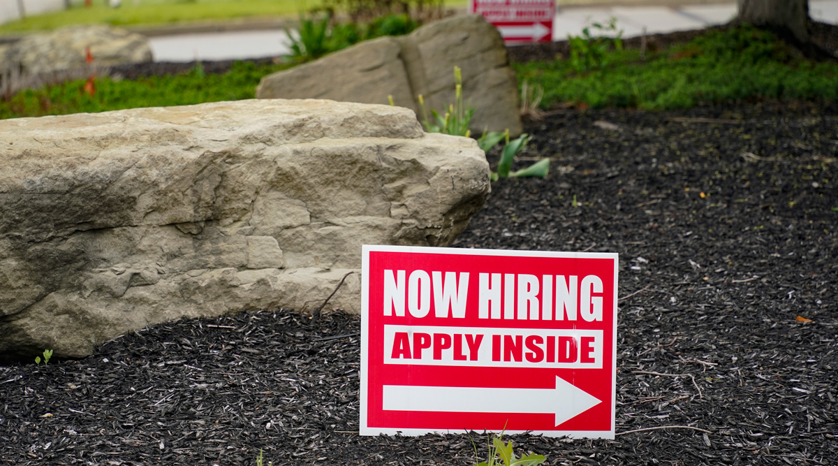 Hiring signs sit outside a gas station in Pennsylvania. (Keith Srakocic/Associated Press)