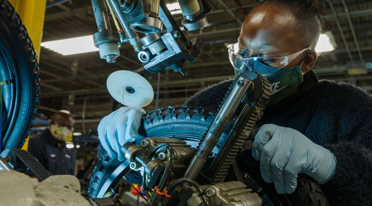 An employee inspects a tire at a bicycle production facility in Manning, S.C. (Micah Green/Bloomberg News)