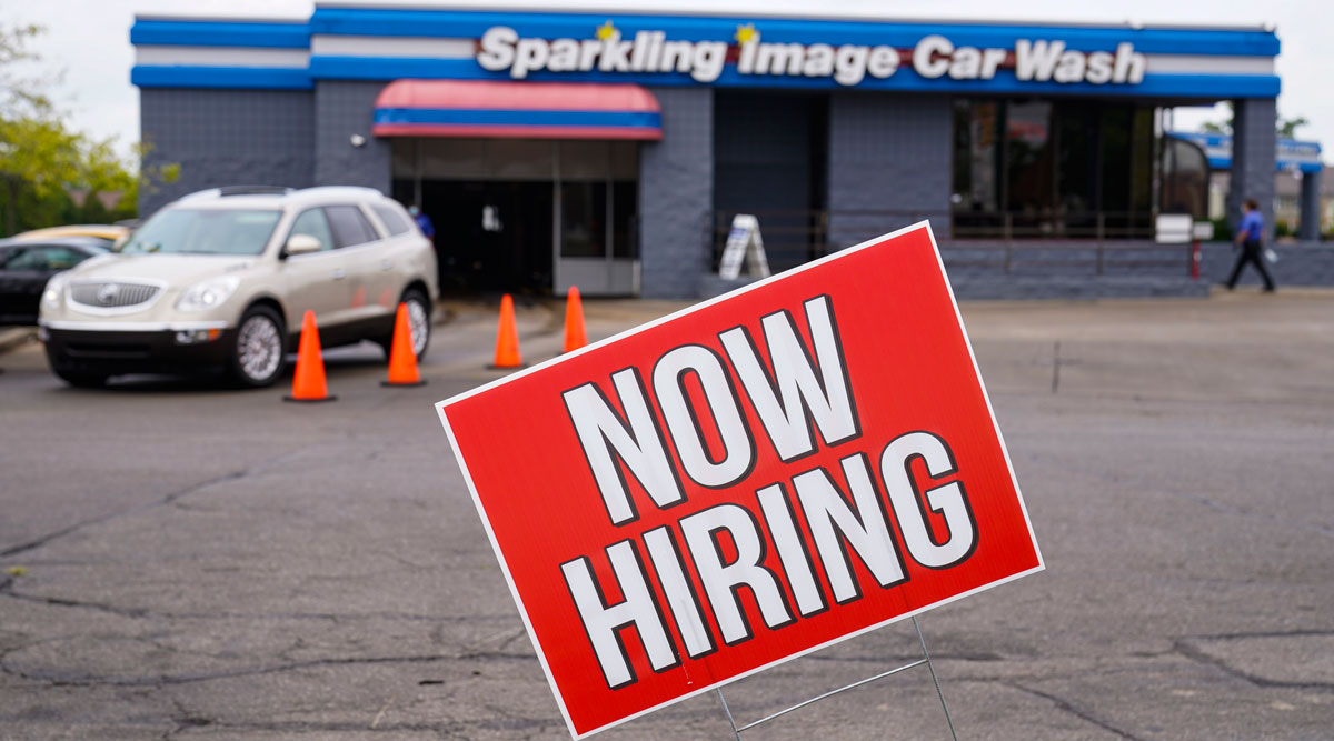 A help wanted sign is displayed outside a car wash in Indianapolis.