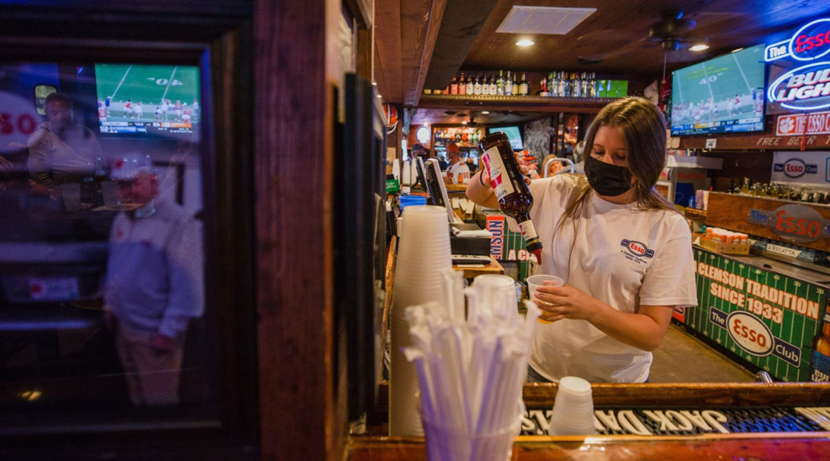 A bartender prepares a drink at a restaurant during Clemson University's first home football game in Clemson, S.C.