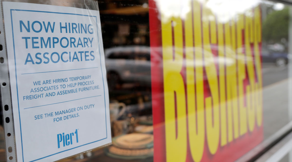 A sign advertises hiring of temporary associates at a Pier 1 store in Florida.