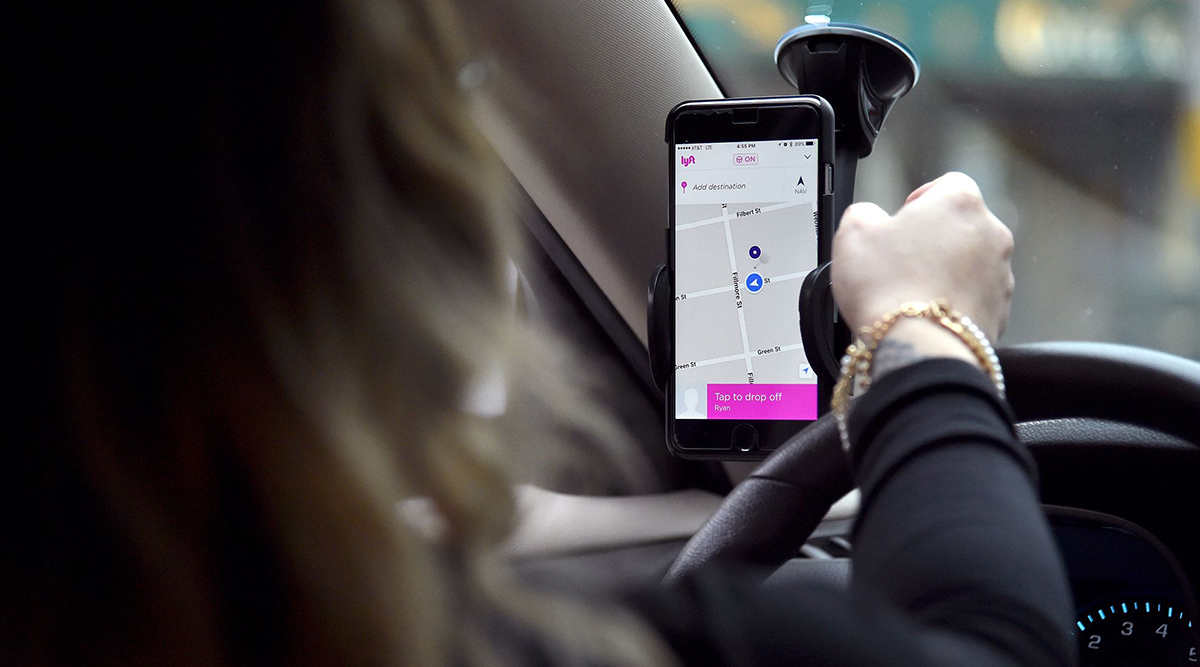 A Lyft driver with map visible on phone