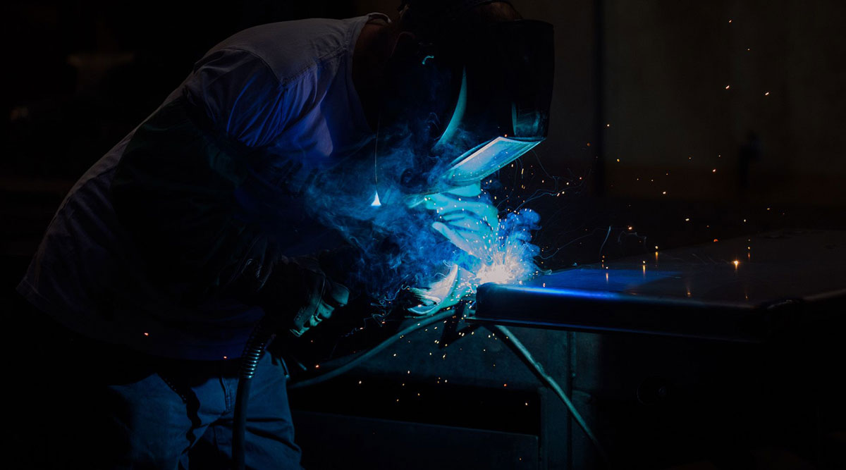 A worker welds parts for a ballot drop box inside a manufacturing facility in Washington.
