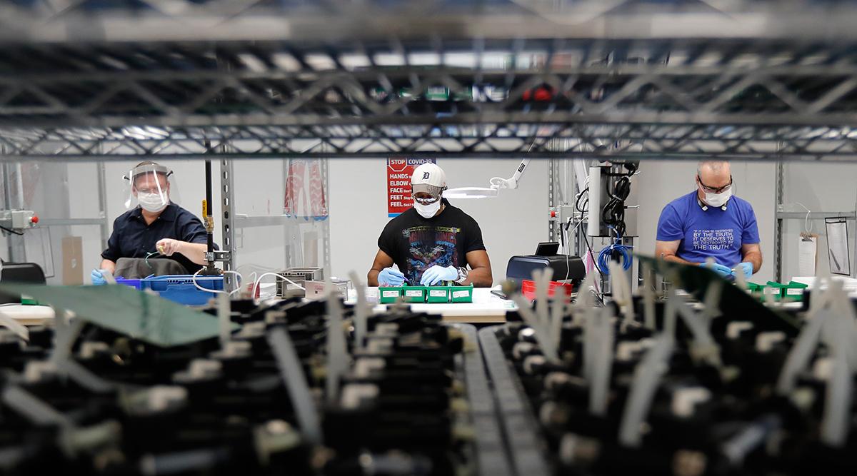 Workers making ventilators