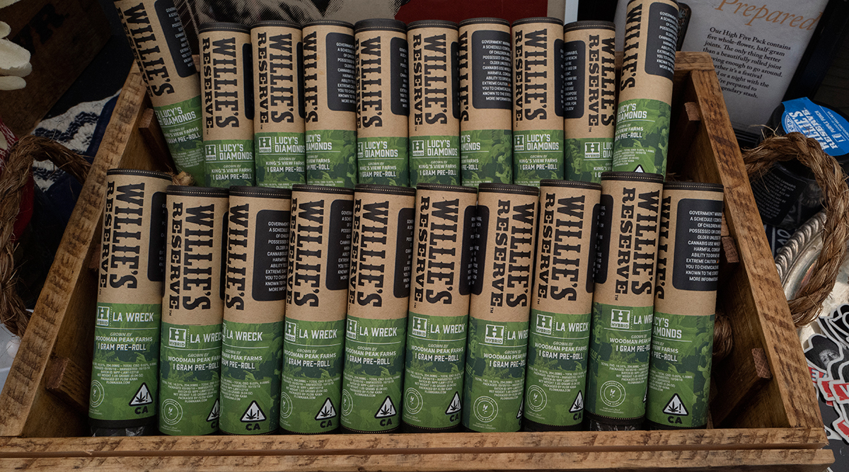 A display of pre-rolled marijuana cigarettes from Willie's Reserve at a section in a farmers market during a business-to-business networking event, WeedCon West 2019, in Los Angeles