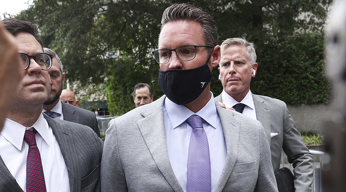Trevor Milton exits courtroom July 29