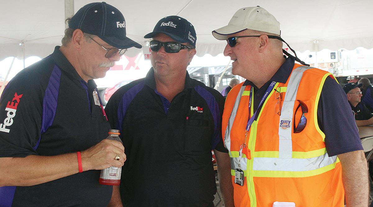 'Brain coach' Scott Mugno with FedEx drivers