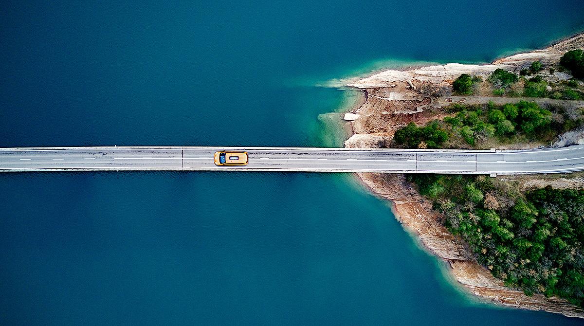 Taxi crossing bridge
