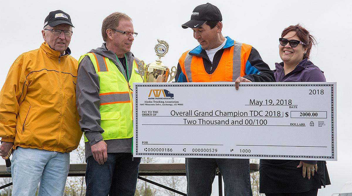 Alaska Grand Champion Ryan Wolcoff holds winner's check