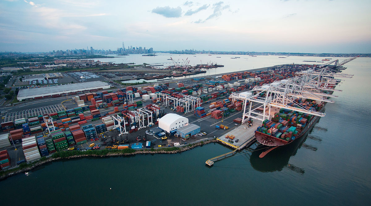 Shipping containers and cargo ships are seen at the Port Jersey Marine Terminal