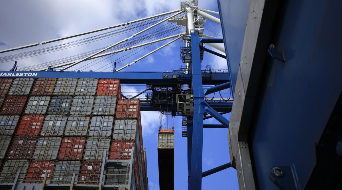 A shipping container is loaded onto a vessel at the Port of Charleston in South Carolina.
