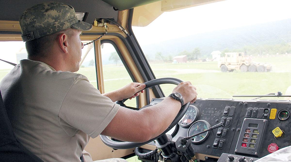 National Guardsman driving truck