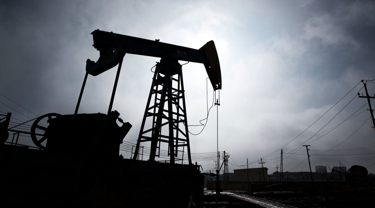 A pumpjack is silhouetted as it operates in Azerbaijan.