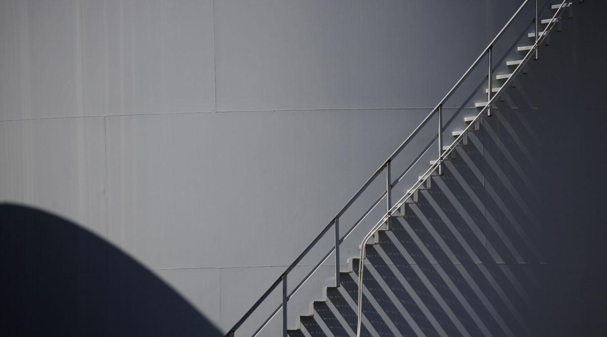 A staircase ascends a storage tank in Port Fourchon, La., on June 11.
