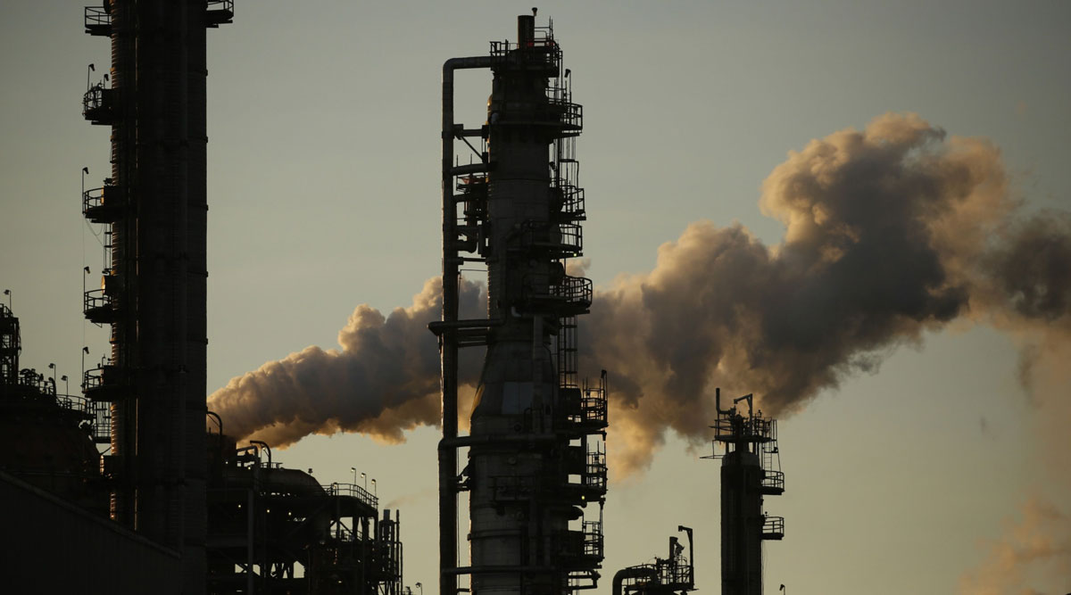 Emissions rise from an oil refinery in Louisiana on June 12.