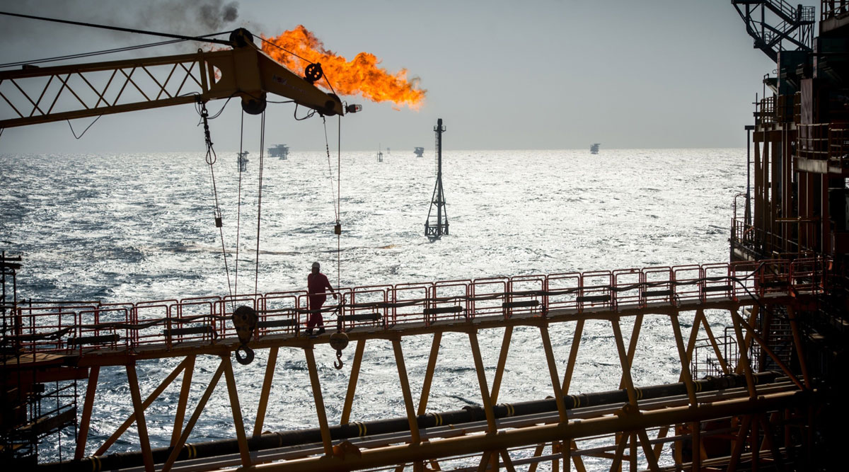 A gas flare burns from a pipe aboard an offshore oil platform in the Permian Gulf's Salman Oil Field in January 2017.
