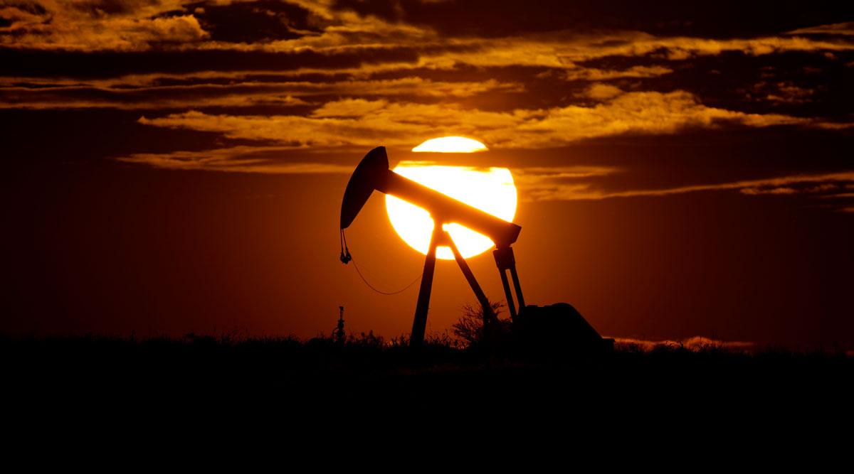 The sun sets behind an idle pump jack near Karnes City, Texas, on April 8.