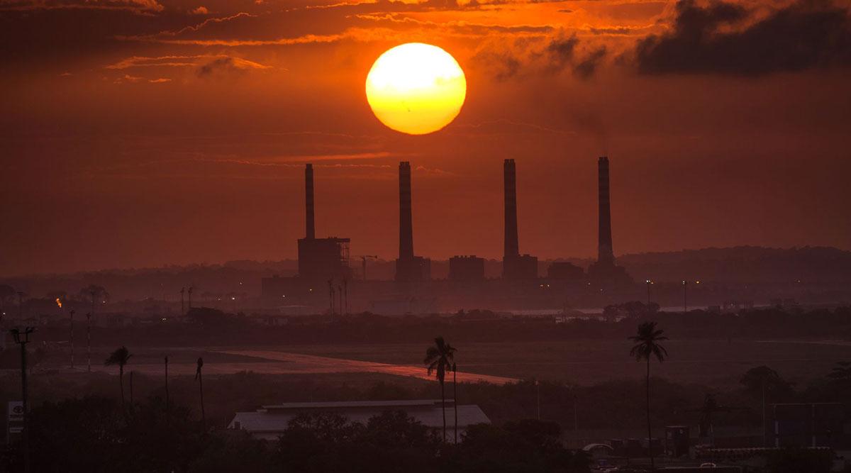 The sun sets over an oil refinery in Puerto Cabello, Venezuela.