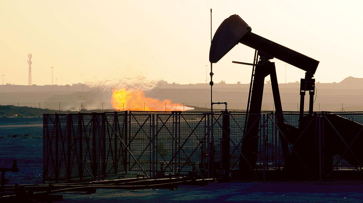 An oil pump operates in an oil field in Awali, Bahrain