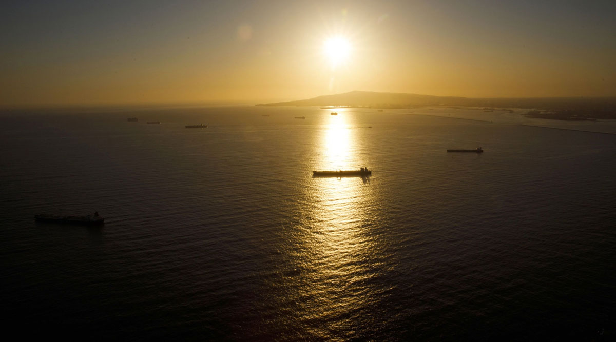 Oil tankers are seen anchored in the Pacific Ocean near Long Beach, Calif.