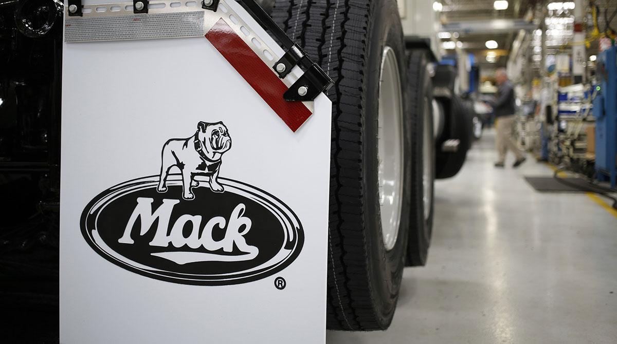 New trucks roll off at a Mack Trucks plant