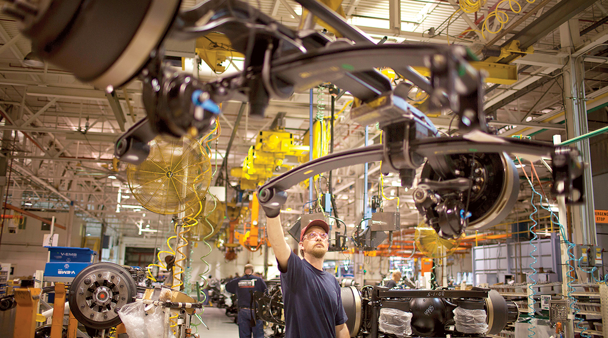 A line worker checks an axle at Volvo's New River Valley Plant in Dublin, Va.