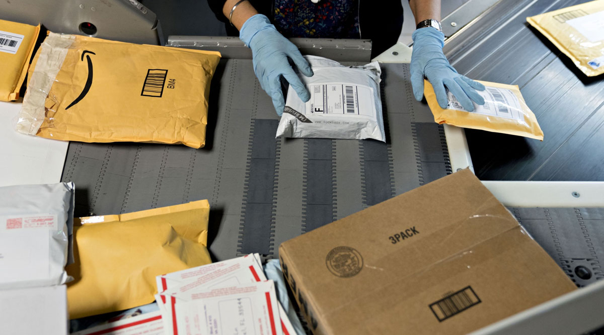 A worker sorts packages at the USPS Merrifield processing and distribution center in Virginia in December 2018.