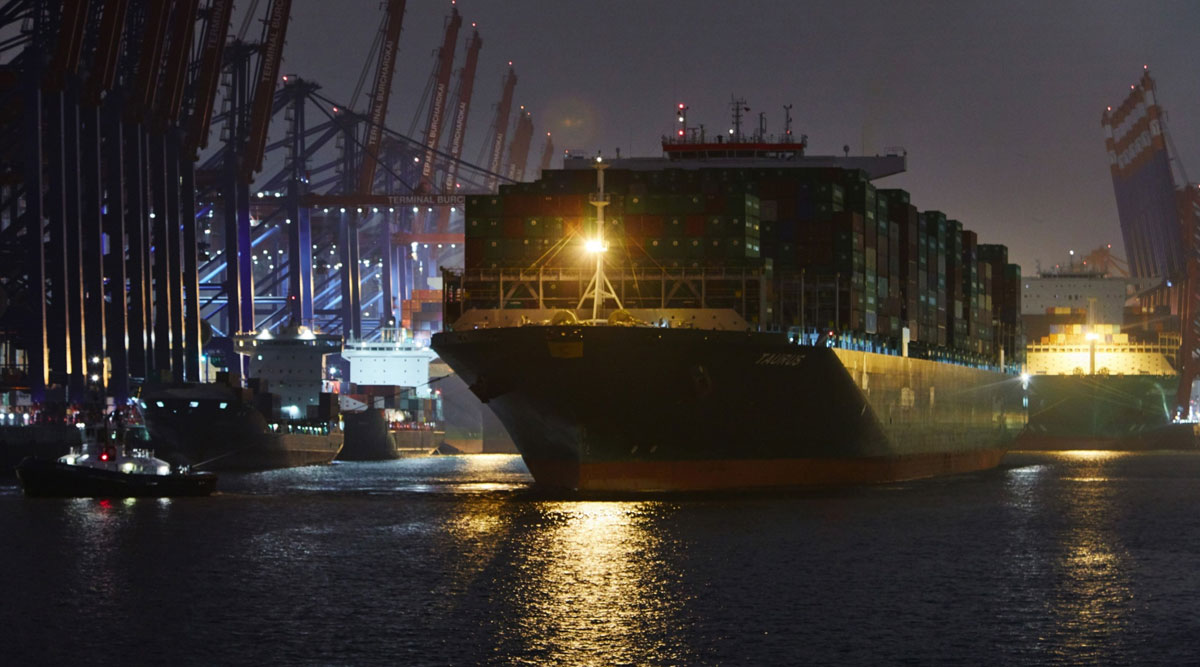 Container ship Taurus, operated by Evergreen Marine Corp., sits with cargo at the Port of Hamburg in Germany on Nov. 10.
