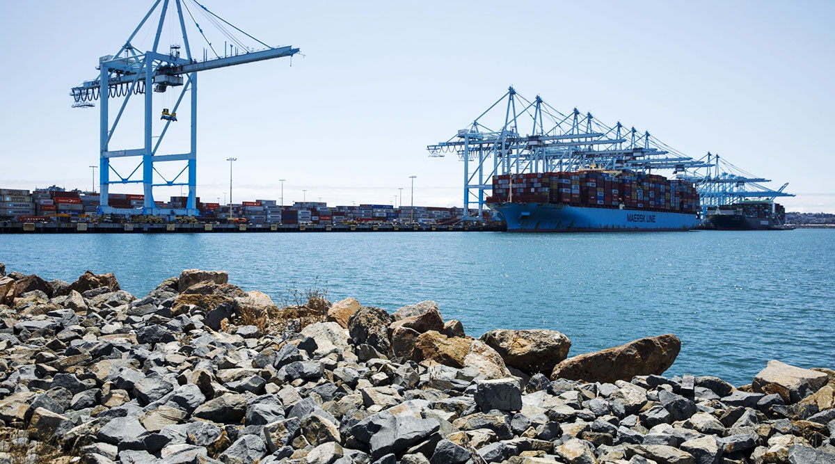 A Maersk ship unloads containers at the Port of Lost Angeles