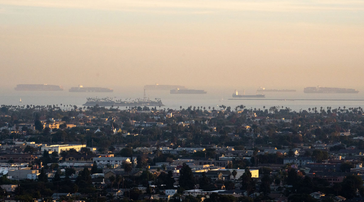 Cargo ships can be seen anchored off the Port of Long Beach and Port of Los Angeles in Signal Hill, Calif., on Nov. 20.