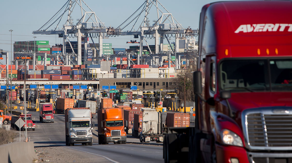 Tractor-trailers move cargo out of the Port of Savannah.