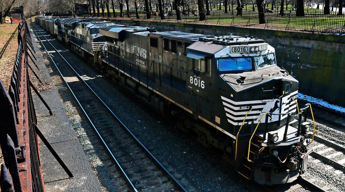 A Norfolk Southern freight train rolls through downtown Pittsburgh. (Gene J. Puskar/Associated Press)